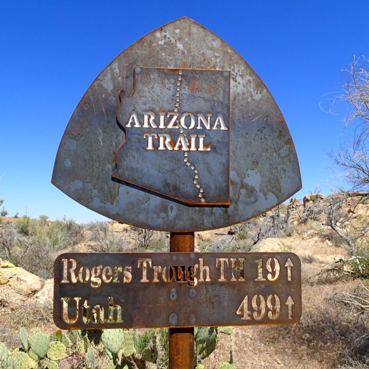 Arizona Trail metal mileage sign that says Rogers Trough TH 19, Utah 499 by Sirena Dufault